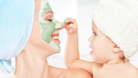Family Beauty Treatment In  Bathroom. Mother And Daughter Baby G